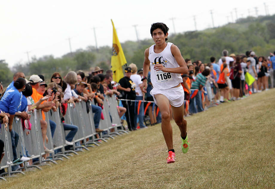 Lytle's Cesar Gonzalez takes first with a time of 15:50.6 in the Division 3A boys race at the Region IV Cross Country Meet on Saturday, Nov. 3, 2012. Photo: Kin Man Hui, Express-News / © 2012 San Antonio Express-News