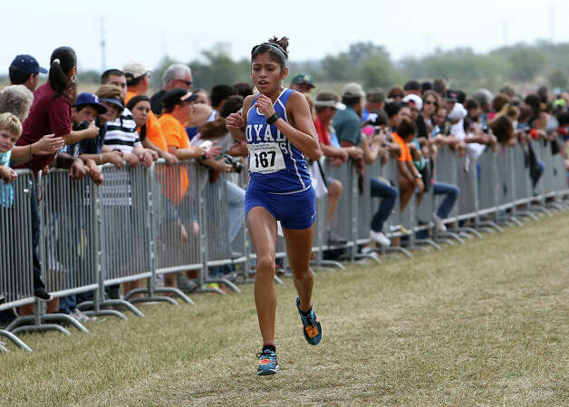 Brookshire Royal's Diana Moreno takes first place with a time of 11:40.2 in the Division 3A girls race at the Region IV Cross Country Meet on Saturday, Nov. 3, 2012. Photo: Kin Man Hui, Express-News / © 2012 San Antonio Express-News