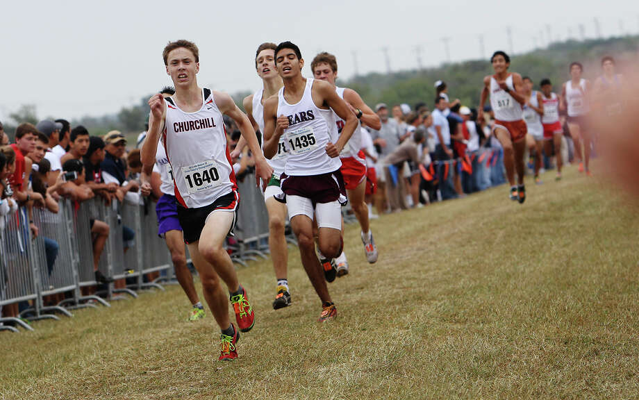 Churchill's Colton Stoker leads a pack of runners to the finish to place fourth with a time of 15:50.1 in the Division 5A boys race at the Region IV Cross Country Meet on Saturday, Nov. 3, 2012. Photo: Kin Man Hui, Express-News / © 2012 San Antonio Express-News