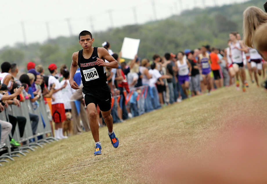 La Joya Palmview's Jose Jaime finishes in third place with a time of 15:41.6 in the Division 5A boys race at the Region IV Cross Country Meet on Saturday, Nov. 3, 2012. Photo: Kin Man Hui, Express-News / © 2012 San Antonio Express-News