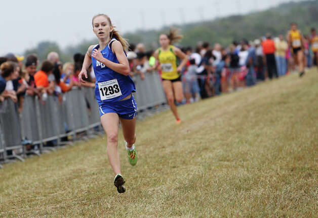 New Braunfels' Paige Hofstad finishes in second place with a time of 18:03.6 in the Division 5A girls race at the Region IV Cross Country Meet on Saturday, Nov. 3, 2012. Photo: Kin Man Hui, Express-News / © 2012 San Antonio Express-News