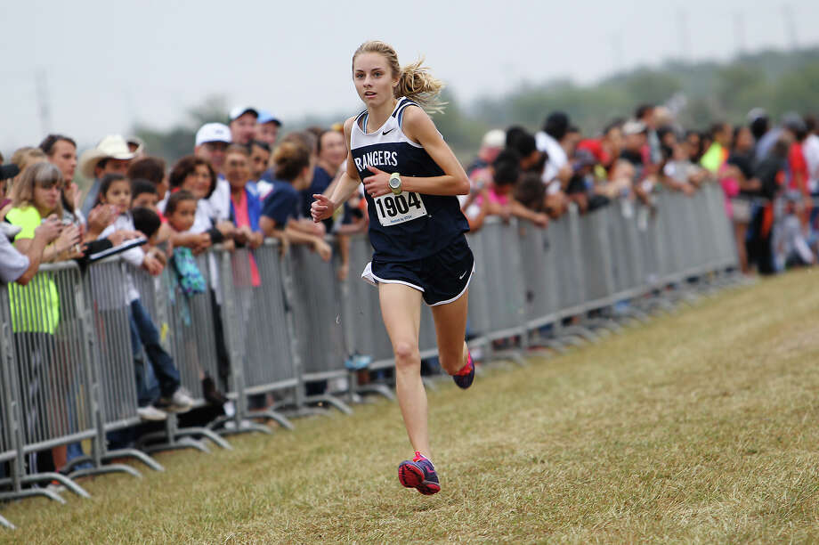 Smithson Valley's Devin Clark cruises to the finish line in first place with a time of 17:47.2 in the Division 5A girls race at the Region IV Cross Country Meet on Saturday, Nov. 3, 2012. Photo: Kin Man Hui, Express-News / © 2012 San Antonio Express-News