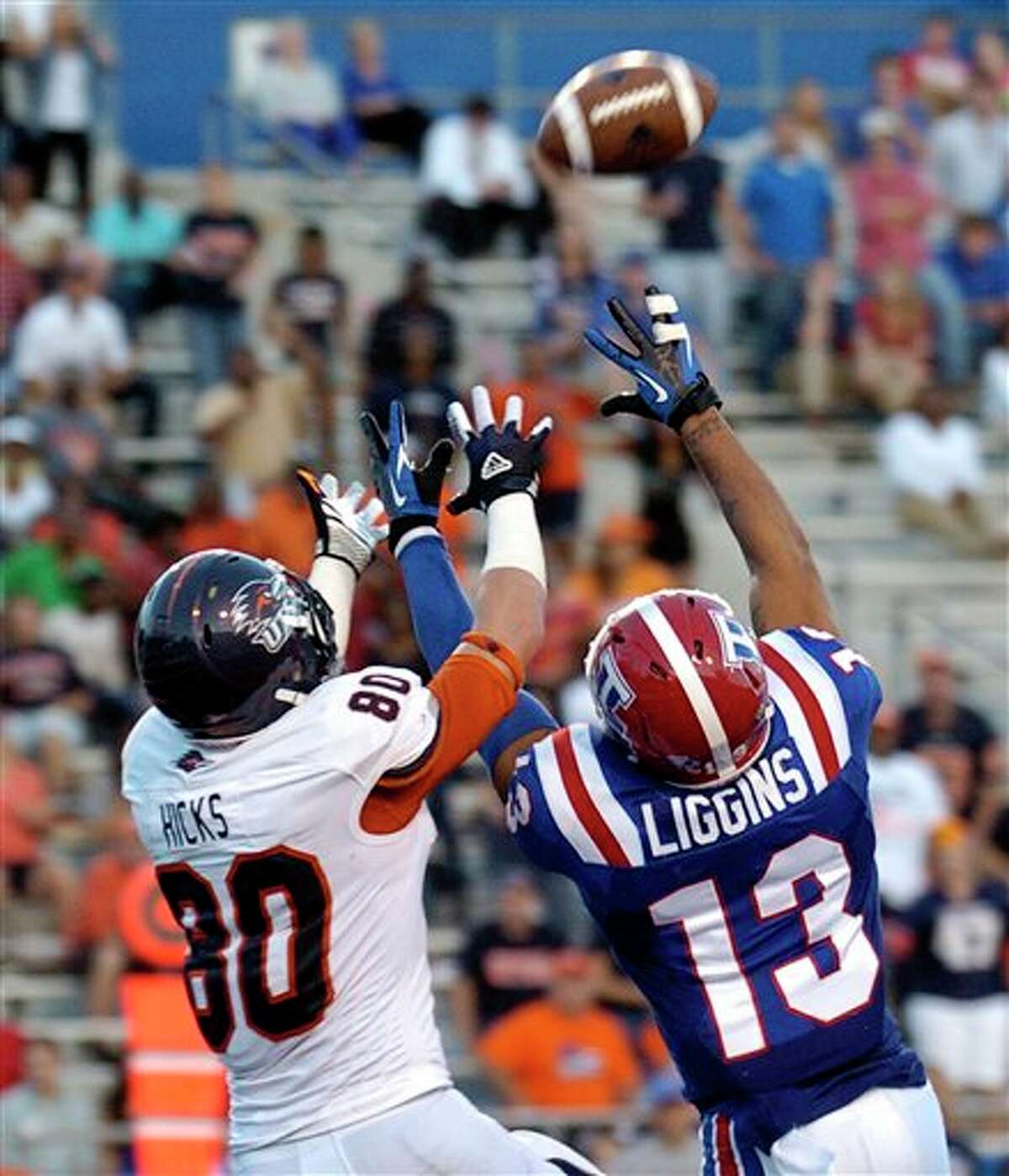 Texas-San Antonio wide receiver Cole Hicks (80) catches a touchdown pass over Louisiana Tech defensive back Le'Vander Liggins (13) during an NCAA college football game in Ruston, La., Saturday, Nov. 3, 2012. Louisiana Tech won 51-27. (AP Photo/Kita Wright)