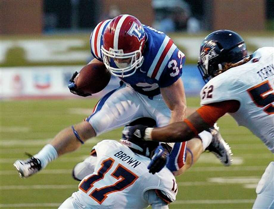 Louisiana Tech running back Ray Holley (32) jumps over Texas-San Antonio's Erik Brown (17) during an NCAA college football game in Ruston, La., Saturday, Nov. 3, 2012. Louisiana Tech won 51-27. (AP Photo/Kita Wright) Photo: Kita Wright, AP / FR156206 AP