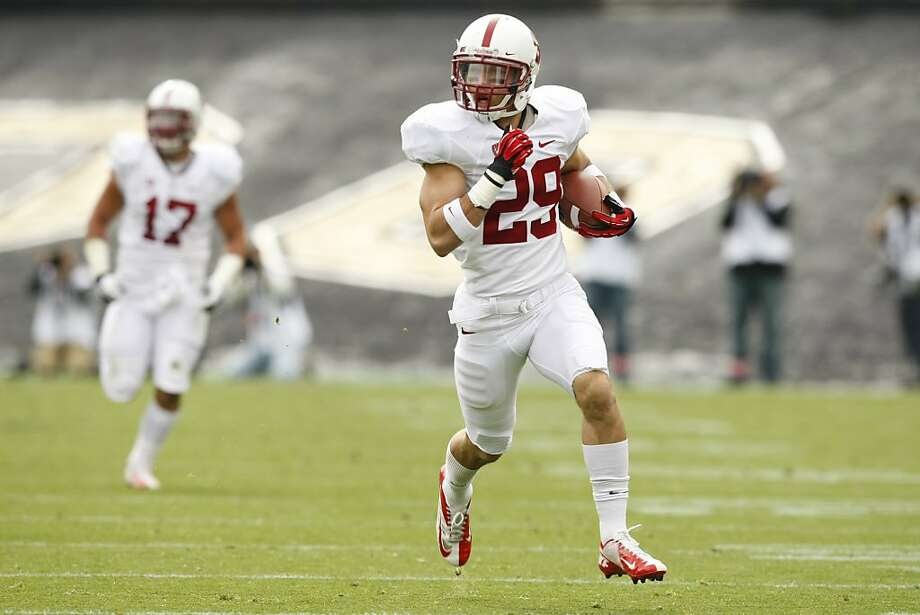 Free safety Ed Reynolds zips toward the end zone on a 52-yard interception return that put Stanford on the scoreboard first, 7-0, in the first quarter. Photo:  Jamie Schwaberow, Stanford Athletics