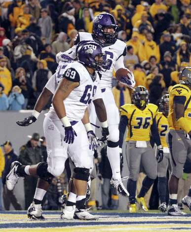 Corey Fuller #86 of the TCU Horned Frogs celebrates after catching a toudown pass in overtime against the West Virginia Mountaineers during the game on November 3, 2012 at Mountaineer Field in Morgantown, West Virginia.  TCU defeated WVU in two overtimes 39-38. Photo: Justin K. Aller, Getty Images / 2012 Getty Images