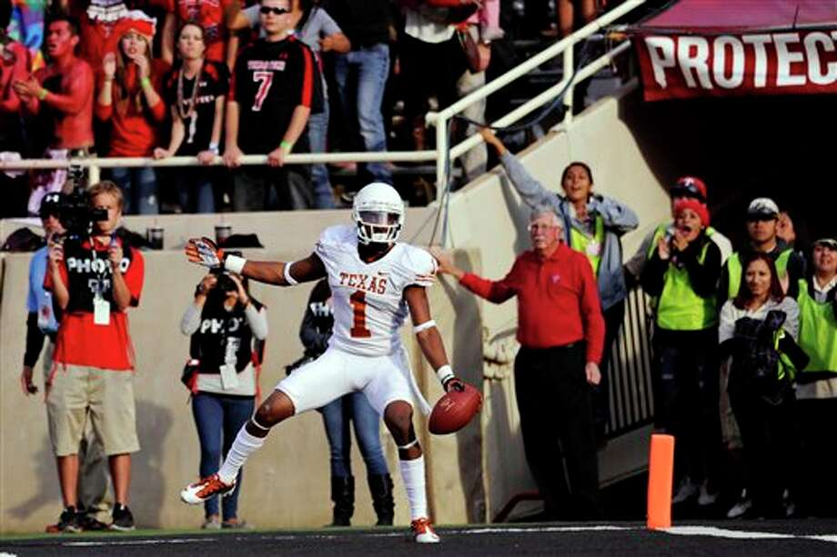 Texas wide receiver Mike Davis celebrates after scoring a touchdown against Texas Tech during the fourth quarter of their NCAA college football game, Saturday, Nov. 3, 2012, in Lubbock, Texas. Texas won 31-22. (AP Photo/The Daily Texan, Elisabeth Dillon) Photo: Elisabeth Dillon, AP / The Daily Texan
