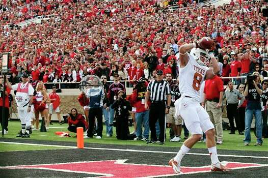 Texas wide receiver Jaxon Shipley (8) catches a touchdown pass against Texas Tech during their NCAA college football game, Saturday, Nov. 3, 2012, in Lubbock, Texas. Texas won 31-22. (AP Photo/The Odessa American, Albert Cesare) Photo: Albert Cesare, AP / The Odessa American
