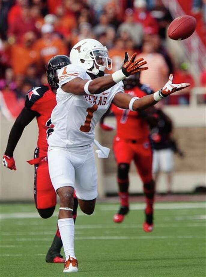 Texas Mike Davis (1) catches a long pass and takes it for a touchdown as Texas Tech defensive back Bruce Jones (24) gives chase during their NCAA college football game, Saturday, Nov. 3, 2012, in Lubbock, Texas. Texas won 31-22. (AP Photo/The Odessa American, Albert Cesare) Photo: Albert Cesare, AP / The Odessa American