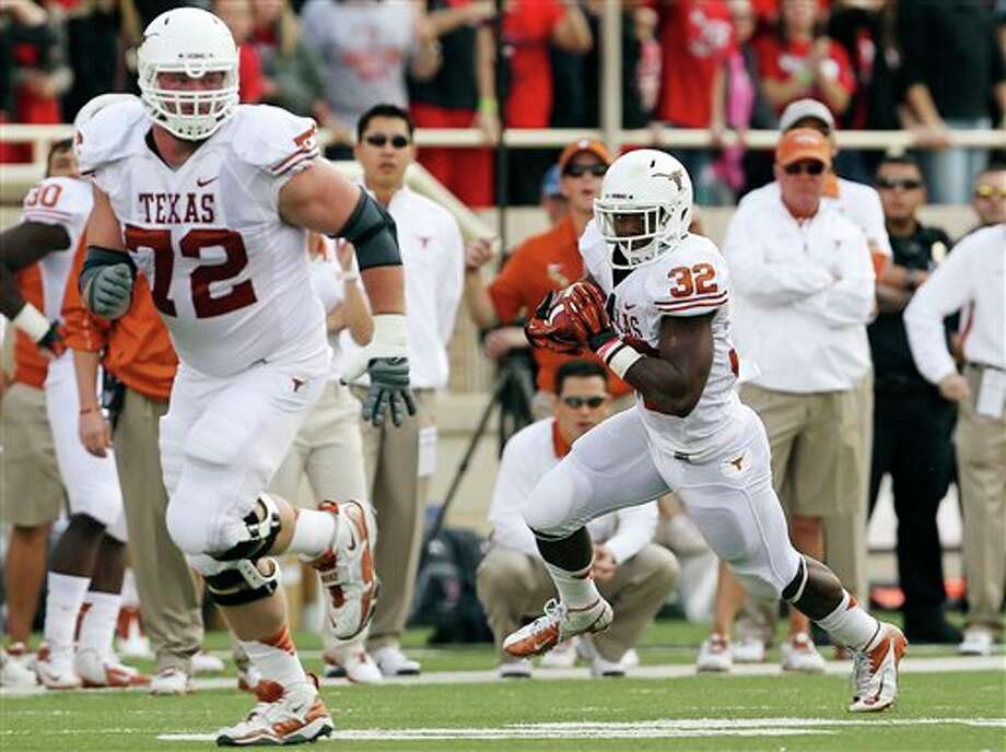 Texas' Mason Walters (72) leads the way for Johnathan Gray (32) on a run against Texas Tech during their NCAA college football game, Saturday, Nov. 3, 2012, in Lubbock, Texas. Texas won 31-22. (AP Photo/Lubbock Avalanche-Journal,Stephen Spillman)  LOCAL TV OUT Photo: Stephen Spillman, AP / The Avalanche-Journal