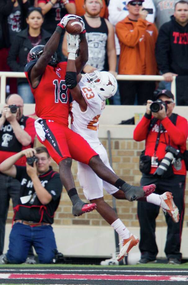 Texas defensive back Carrington Byndom (23) breaks up a pass in the end zone to Texas Tech's Eric Ward late in the second half at Jones AT&T Stadium in Lubbock, Texas, on Saturday, November 3, 2012. (Ricardo Brazziell/Austin American-Statesman/MCT) Photo: Ricardo Brazziell, McClatchy-Tribune News Service / Austin American-Statesman