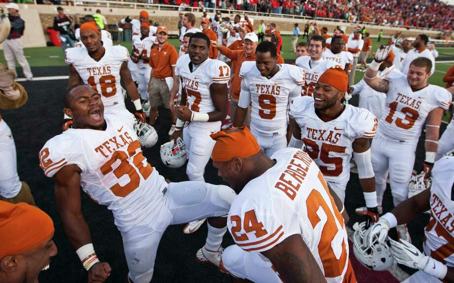 Texas' Johnathan Gray (32) helps lead the celebration of a 31-22 win over Texas Tech at Jones AT&T Stadium in Lubbock, Texas, on Saturday, November 3, 2012. (Ricardo Brazziell/Austin American-Statesman/MCT) Photo: Ricardo Brazziell, McClatchy-Tribune News Service / Austin American-Statesman