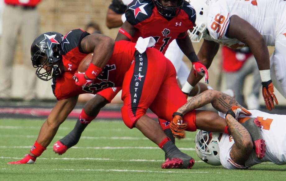 Texas Tech running back Kenny Williams (34) is brought down by Texas' Cayleb Jones (4) at Jones AT&T Stadium in Lubbock, Texas, on Saturday, November 3, 2012. Texas won, 31-22. (Ricardo Brazziell/Austin American-Statesman/MCT) Photo: Ricardo Brazziell, McClatchy-Tribune News Service / Austin American-Statesman