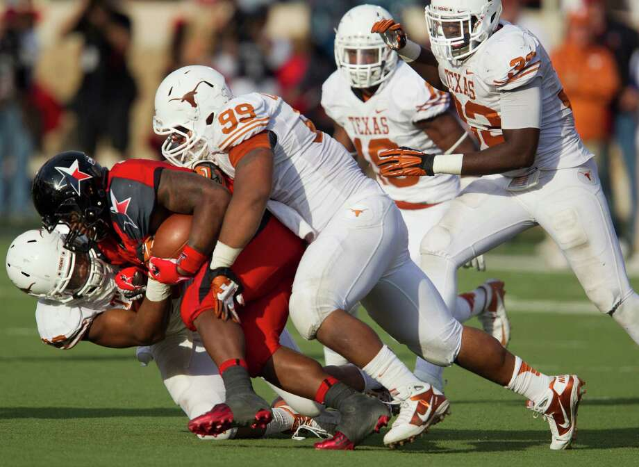 Texas' defense stops Texas Tech running back Kenny Williams for a loss at Jones AT&T Stadium in Lubbock, Texas, on Saturday, November 3, 2012. Texas won, 31-22. (Ricardo Brazziell/Austin American-Statesman/MCT) Photo: Ricardo Brazziell, McClatchy-Tribune News Service / Austin American-Statesman
