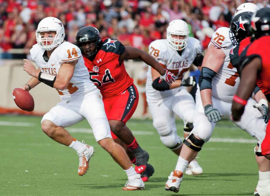 Texas' David Ash (14) looks for room to run against Texas Tech in the second half at Jones AT&T Stadium in Lubbock, Texas, on Saturday, November 3, 2012. Texas won, 31-22. (Ricardo Brazziell/Austin American-Statesman/MCT) Photo: Ricardo Brazziell, McClatchy-Tribune News Service / Austin American-Statesman