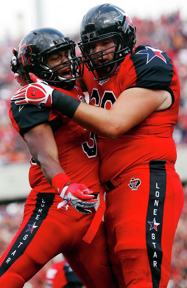 Texas Tech's Kenny Williams, left, and Terry McDaniel celebrate a touchdown against Texas during their NCAA college football game, Saturday, Nov. 3, 2012, in Lubbock, Texas. (AP Photo/Lubbock Avalanche-Journal,Stephen Spillman)  LOCAL TV OUT Photo: Stephen Spillman, Associated Press / The Avalanche-Journal