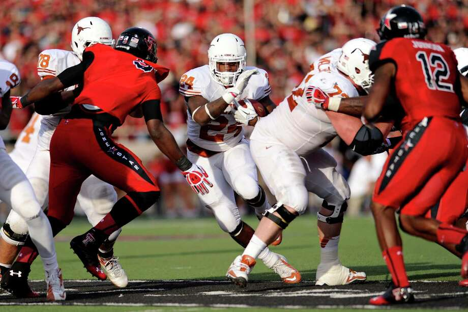 Texas running back Joe Bergeron (24) looks for a hole in the Texas Tech defense during the fourth quarter of their NCAA college football game, Saturday, Nov. 3, 2012, in Lubbock, Texas. Texas won 31-22. (AP Photo/The Daily Texan, Elisabeth Dillon) Photo: Elisabeth Dillon, Associated Press / The Daily Texan