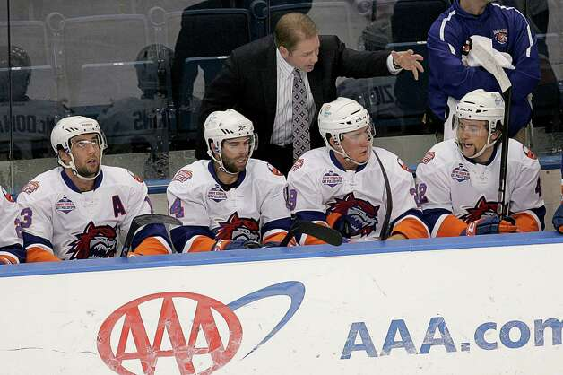 Mike Ross Connecticut Post freelance - Soundtigers Head Coach Scott Pellerin chats with plays on bench during Saturday's match against the Hershey Bears AHL game. Photo: Mike Ross / Connecticut Post Freelance