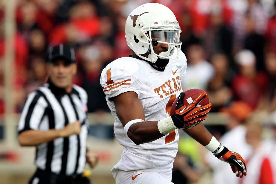 Texas' Mike Davis scores a touchdown against Texas Tech during their NCAA college football game, Saturday, Nov. 3, 2012, in Lubbock, Texas. (AP Photo/Lubbock Avalanche-Journal,Stephen Spillman)  LOCAL TV OUT Photo: Stephen Spillman, Associated Press / The Avalanche-Journal