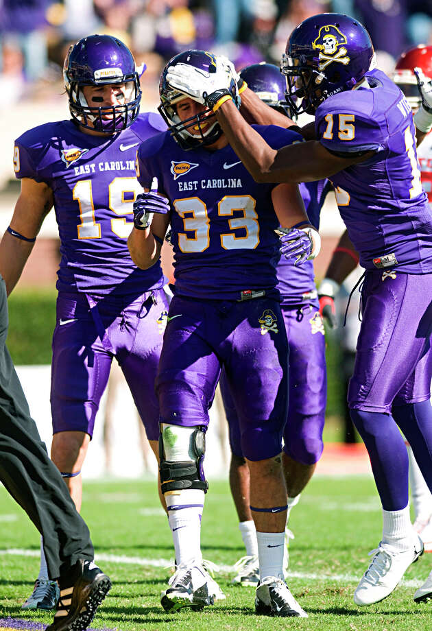 East Carolina's Danny Webster (33) is congratulated by Andrew Bodenheimer (19) and Reese Wiggins (15) after scoring a touchdown against Houston during their NCAA college football game, Saturday, Nov. 3, 2012, in Greenville, N.C. East Carolina won 48-28. (AP Photo/The Daily Reflector, Scott Davis) Photo: Scott Davis, Associated Press / The Daily Reflector