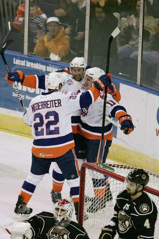 Mike Ross Connecticut Post freelance - Soundtigers # 11 Casey Cizikas celebrates with teammates # 22 Nino Niederreiter and # 13 Colin McDonald after Cizikas first period goal against the Hershey Bears on Saturday evening. Photo: Mike Ross / Connecticut Post Freelance