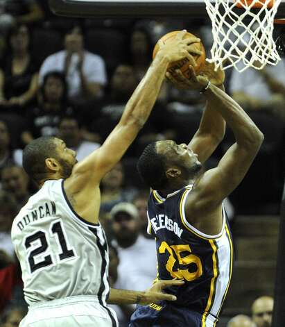 Tim Duncan, left, of the San Antonio Spurs, blocks a shot by Al Jefferson of the Utah Jazz during NBA action at the AT&T Center on Saturday, Nov. 3, 2012. (San Antonio Express-News)