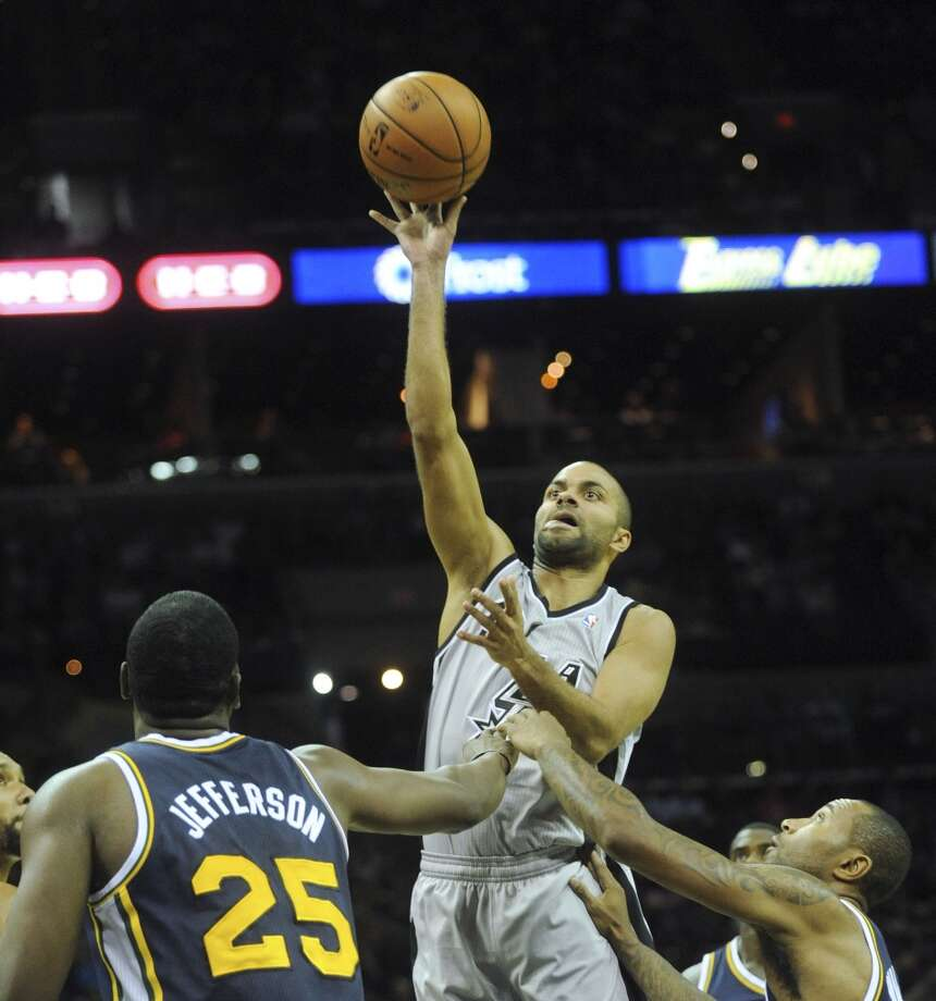 San Antonio guard Tony Parker shoots and scores against the Utah Jazz during first-quarter NBA action at the AT&T Center on Saturday, Nov. 3, 2012. (San Antonio Express-News)
