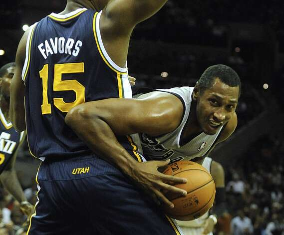 San Antonio Spurs forward Boris Diaw attempts to go around Derrick Favors of the Utah Jazz during first-half NBA action at the AT&T Center on Saturday, Nov. 3, 2012. (San Antonio Express-News)