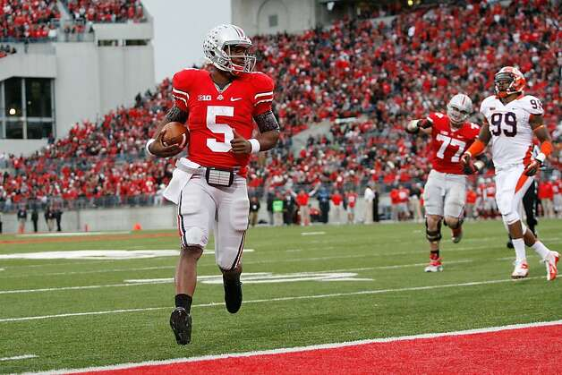Braxton Miller runs for a score during Ohio State's 52-22 defeat of Illinois. He also threw for two touchdowns. Photo: Kirk Irwin, Getty Images