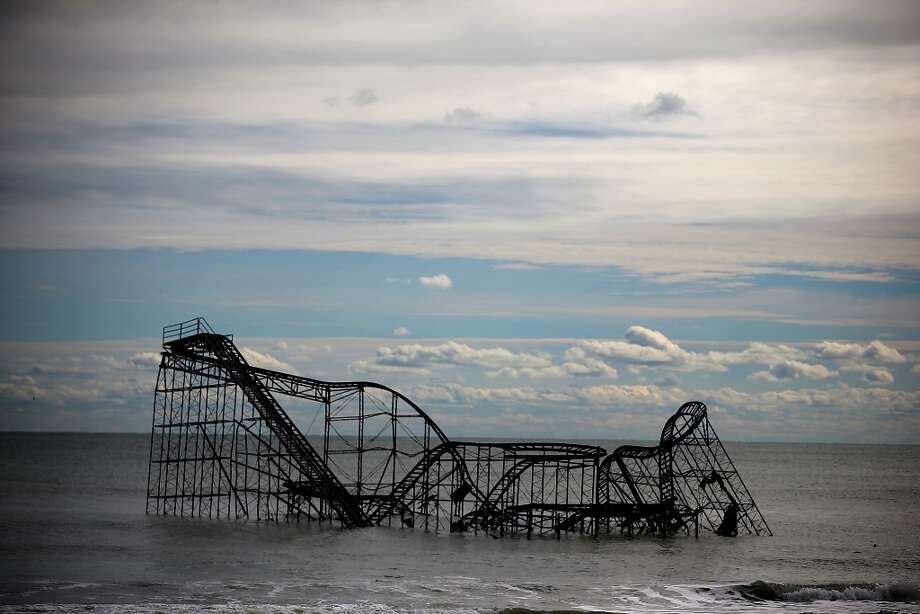 HURRICANE SANDY:A roller coaster sits in the Atlantic Ocean after the Fun Town pier it sat on was destroyed by what came to be known as Superstorm Sandy on Nov. 1, 2012, in Seaside Heights, N.J. The East Coast contended with floods, fires and power outages after Superstorm Sandy. Photo: Mark Wilson, Getty Images / 2012 Getty Images