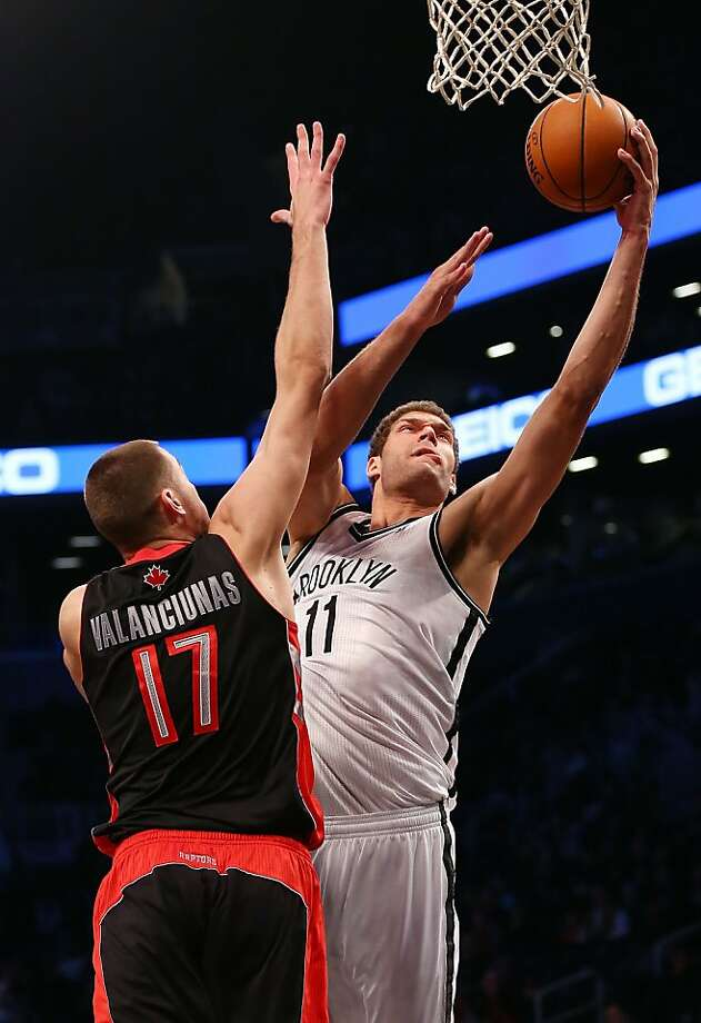 Brook Lopez (right) of the Nets scored 27 points as the hosts won the first NBA game played in Brooklyn. Photo: Alex Trautwig, Getty Images