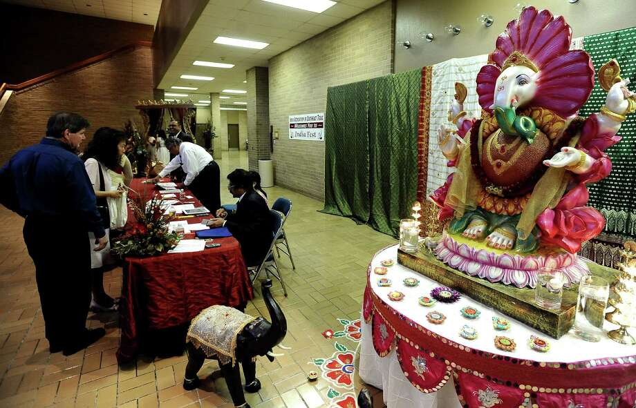 The India Association of Southeast Texas gathered with community members to celebrate INDIAFEST 2012 at the Beaumont Civic Center on Saturday, November 3, 2012.  The guests were welcomed by the statue of the Ganpati, the elephant-headed God, who is the God of power and wisdom. Photo taken: Randy Edwards/The Enterprise Photo: Randy Edwards