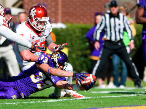 East Carolina's Danny Webster (33) reaches for a touchdown against Houston during their NCAA college football game, Saturday, Nov. 3, 2012, in Greenville, N.C. East Carolina won 48-28. (AP Photo/The Daily Reflector, Scott Davis) Photo: Scott Davis, Associated Press / The Daily Reflector