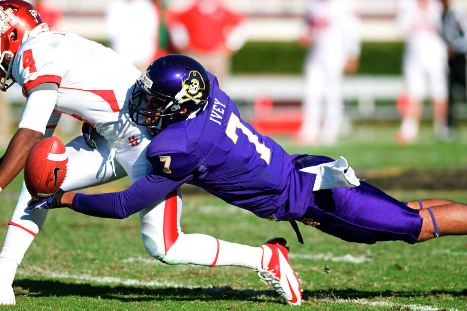 East Carolina's Lamar Ivey (7) breaks up a pass intended for Houston's Ronniw Williams (4) during their NCAA college football game, Saturday, Nov. 3, 2012, in Greenville, N.C. East Carolina won 48-28. (AP Photo/The Daily Reflector, Scott Davis) Photo: Scott Davis, Associated Press / The Daily Reflector