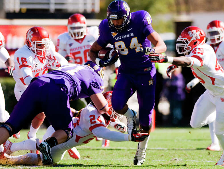 East Carolina's Justin Jones (84) runs the ball against Houston during their NCAA college football g