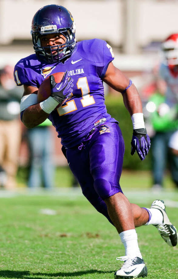 East Carolina's Vintavious Cooper (21) runs the ball against Houston during their NCAA college football game, Saturday, Nov. 3, 2012, in Greenville, N.C. East Carolina won 48-28. (AP Photo/The Daily Reflector, Scott Davis) Photo: Scott Davis, Associated Press / The Daily Reflector