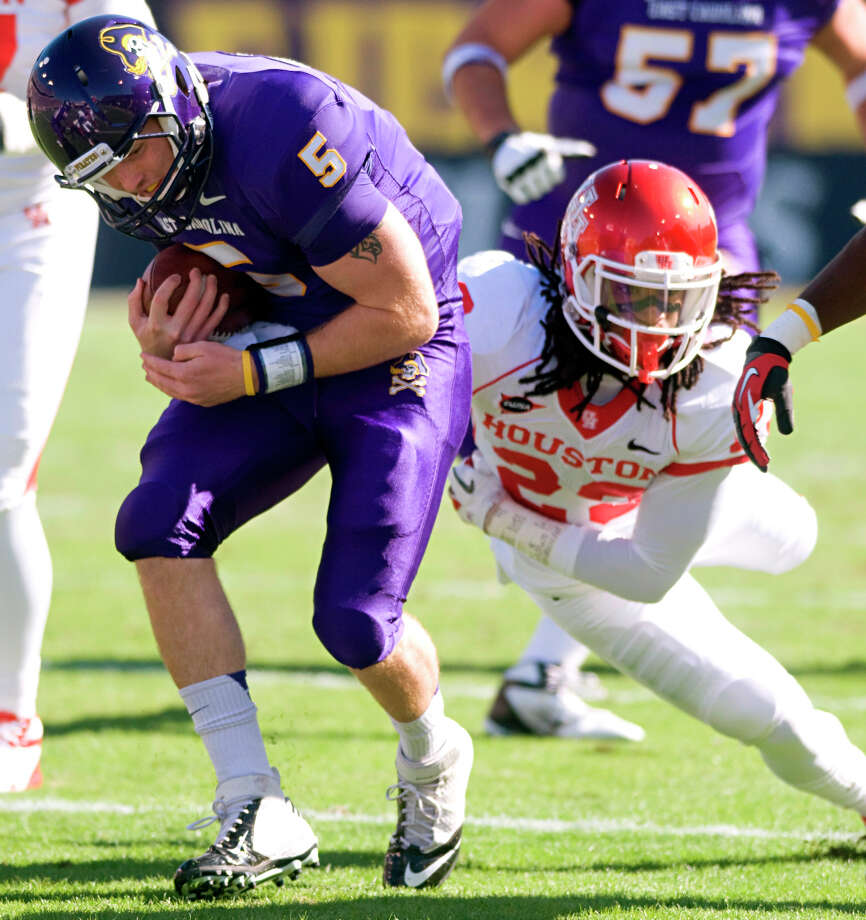 East Carolina's Shane Carden (5) is brought down by Houston's Trevon Stewart (23) during their NCAA college football game, Saturday, Nov. 3, 2012, in Greenville, N.C. East Carolina won 48-28. (AP Photo/The Daily Reflector, Scott Davis) Photo: Scott Davis, Associated Press / The Daily Reflector