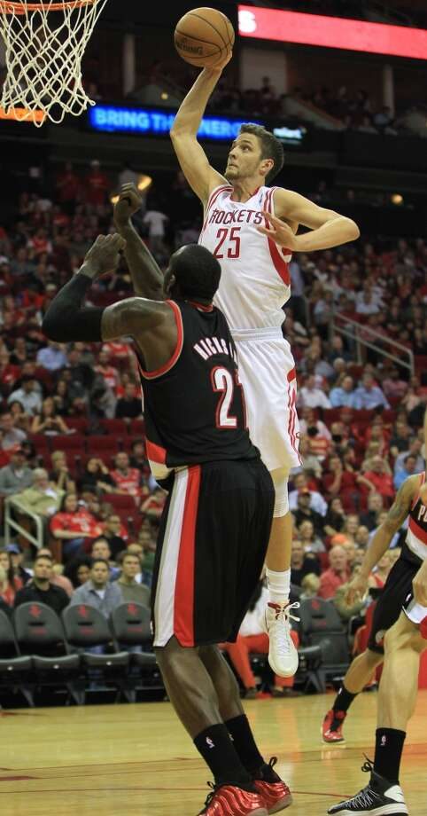 Houston's Chandler Parsons (25) dunks the ball over Portland's J.J. Hickson (21) during the first half of the home opener NBA game at Toyota Center, Saturday, Nov. 3, 2012, in Houston. (Karen Warren / Houston Chronicle)