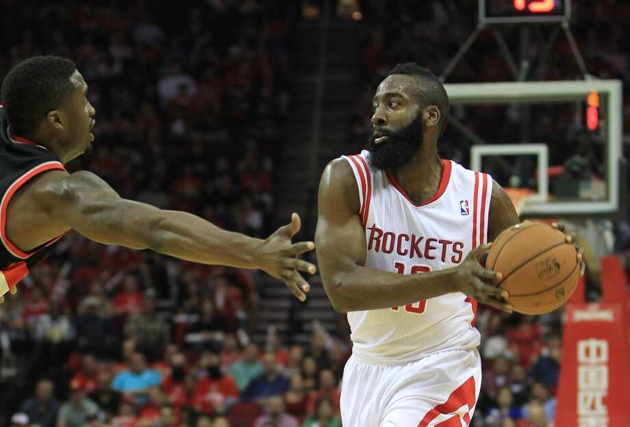 Houston's James Harden (13) looks to pass the ball during the first half of the home opener NBA game at Toyota Center, Saturday, Nov. 3, 2012, in Houston. (Karen Warren / Houston Chronicle)