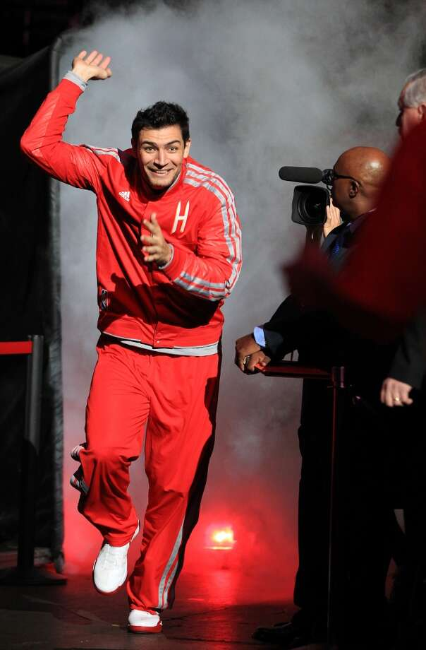 Rockets Carlos Delfino fights off the smog during player introductions before the start of the home opener NBA game at Toyota Center, Saturday, Nov. 3, 2012, in Houston.  (Karen Warren / Houston Chronicle)