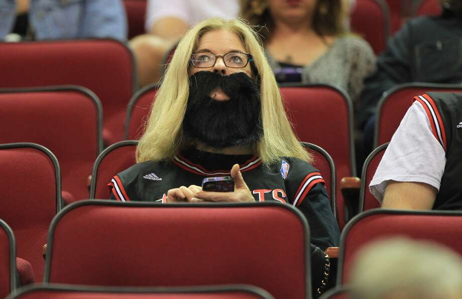 Jane Wagner wears her beard before the start of the home opener NBA game at Toyota Center, Saturday, Nov. 3, 2012, in Houston. (Karen Warren / Houston Chronicle)