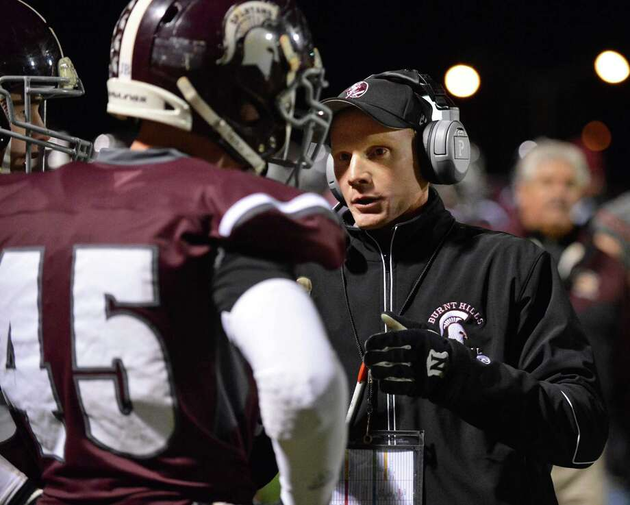 Burnt Hills head coach Matt Shell with #45 Tom Keyes on the  sidelines during the Class A Super Bowl against Amsterdam at Shenendehowa High Saturday Nov. 3, 2012.   (John Carl D'Annibale / Times Union) Photo: John Carl D'Annibale / 00019922A