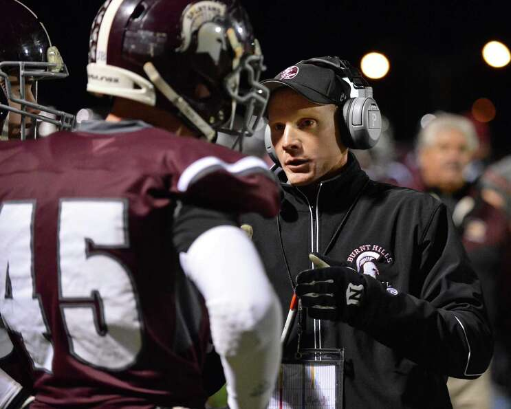 Burnt Hills head coach Matt Shell with #45 Tom Keyes on the  sidelines during the Class A Super Bowl