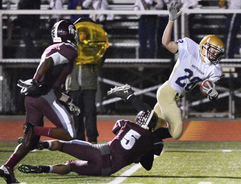 Burnt Hills' #5 Mike Danz brings down Amsterdam's # 28 Brett Stanavich during the Class A Super Bowl