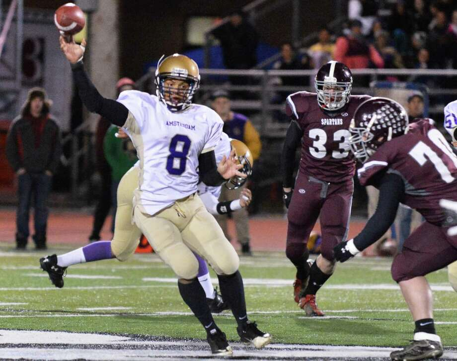 Amsterdam's quarterback #8 Geo Rodriguez passes to Hector Diaz during the Class A Super Bowl game against against Burnt Hills at Shenendehowa High Saturday Nov. 3, 2012.   (John Carl D'Annibale / Times Union) Photo: John Carl D'Annibale / 00019922A