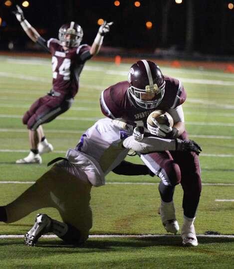 Burnt Hills' #24 Josh Quesada ,top left, signals a touchdown as teammate #11 Dan Maynard scores agai