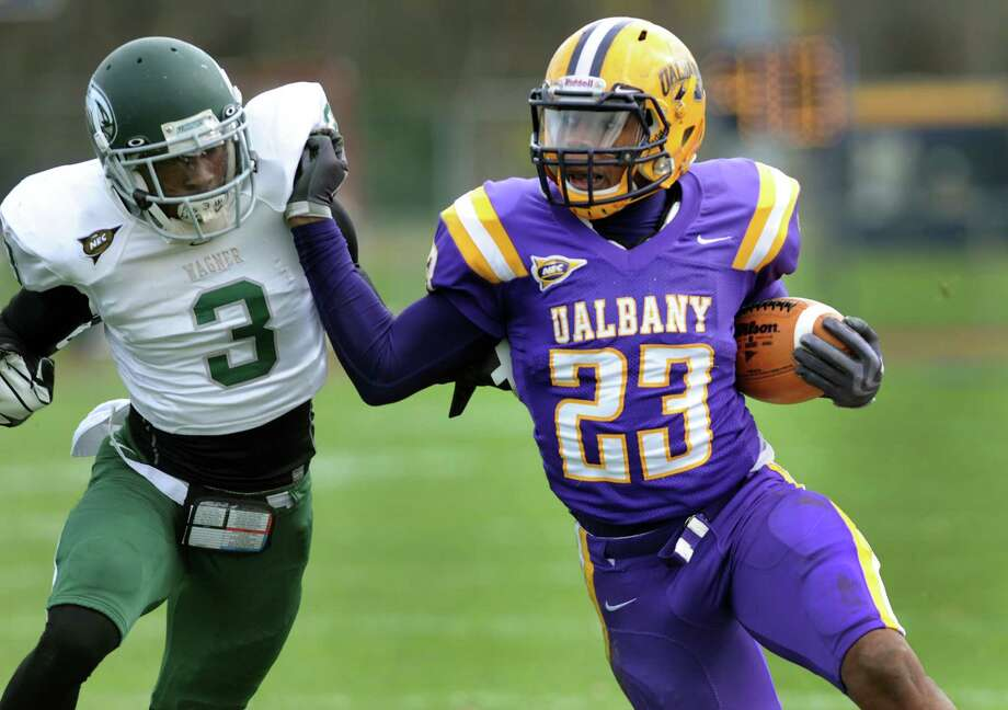 UAlbany's Omar Osbourne (23), right, fights off Wagner's Torian Phillips (3) during their football game on Saturday, Nov. 3, 2012, at UAlbany in Albany, N.Y. (Cindy Schultz / Times Union) Photo: Cindy Schultz / 00019933A