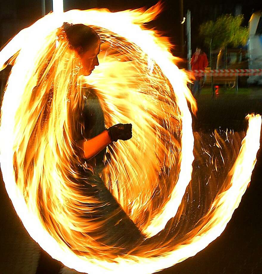 Choreography of flame:A member of the Fire Dance Group twirls torches during a performance in Vilnius, Lithuania. Photo: Petras Malukas, AFP/Getty Images