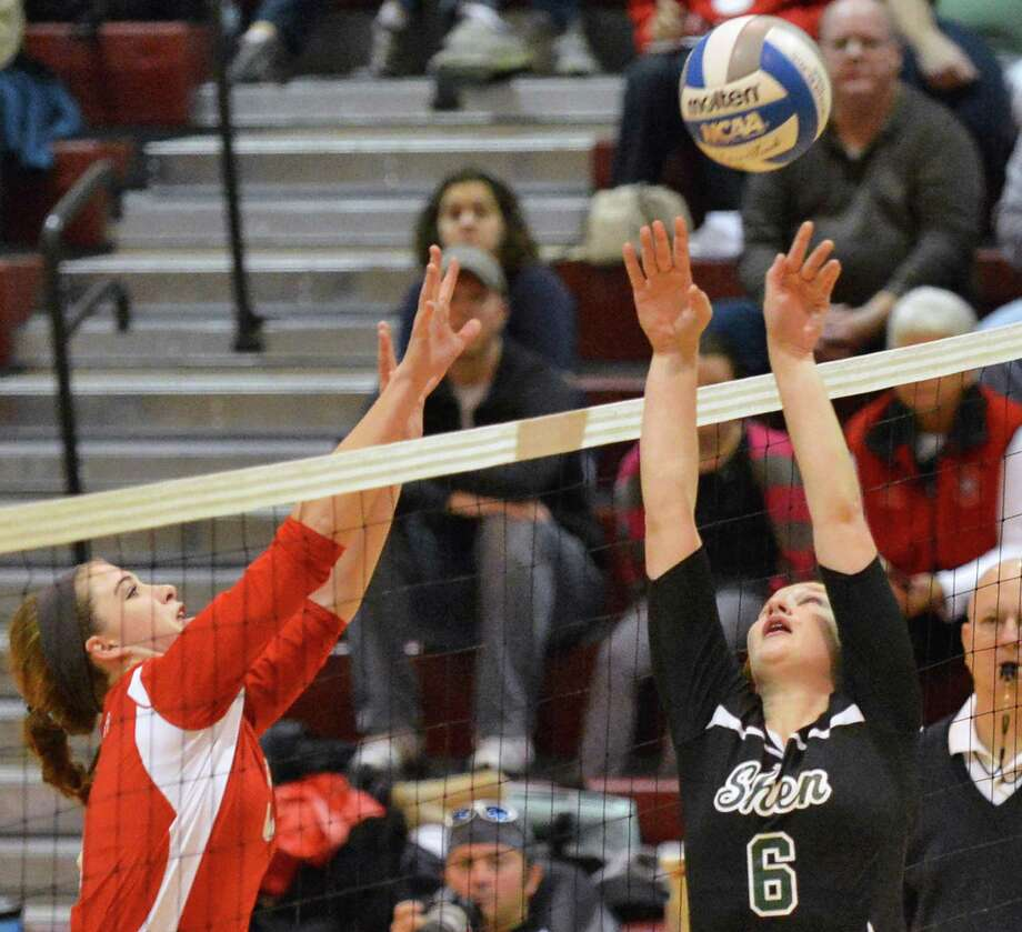 Guilderland's #5 Allison VanDoren, left, and Shen's #6 Hayley Macken at the net during the Section II Girls' Volleyball Finals at Stillwater High Saturday Nov. 3, 2012.  (John Carl D'Annibale / Times Union) Photo: John Carl D'Annibale / 00019925A