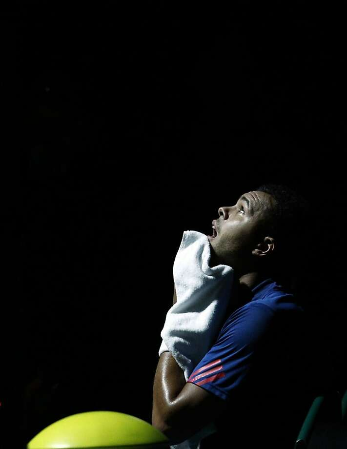 Jo-Wilfried Tsonga wipes his face during his quarterfinal match against David Ferrer of Spain at the Paris Tennis Masters tournament, Friday, Nov. 2, 2012. Photo: Christophe Ena, Associated Press